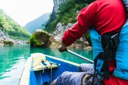 man paddling in beautiful blue river