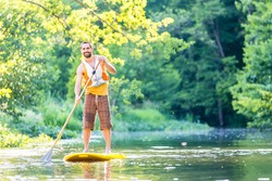 Man paddling on SUP in river