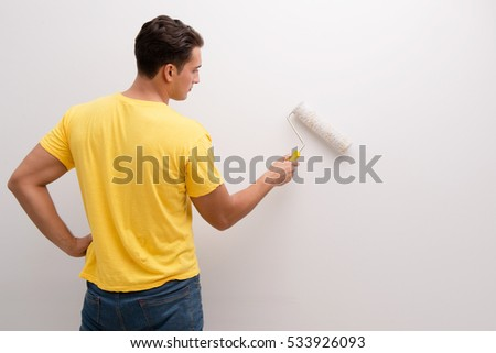 Man Painting the Wall Free Photo - Avopix com