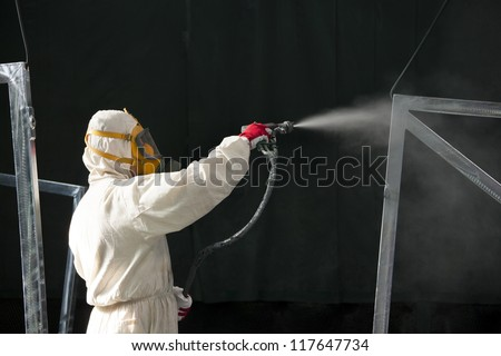 man painting with airbrush - stock photo