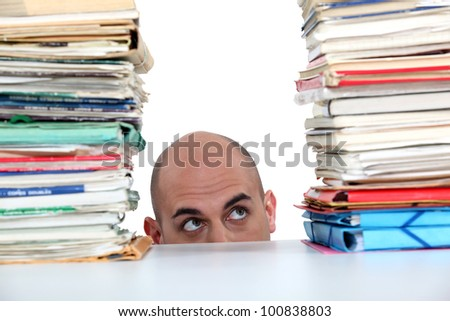 Man peering at files