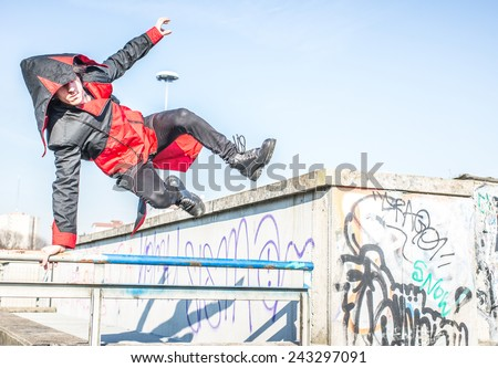man performing parkour move outdoor with cosplay costume