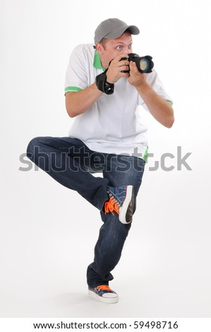 Man photographer with camera in funny pose on withe background
