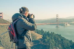 Man photographing San Francisco cityscape from Twin Peaks