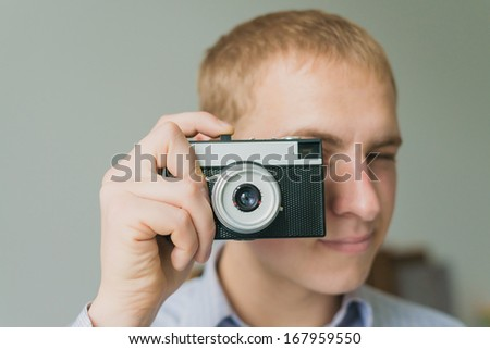 Man photographs on film camera