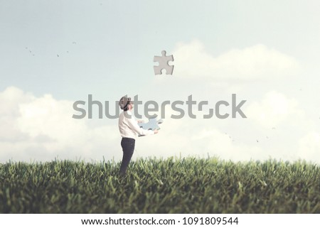 man places last piece of sky puzzle surreal concept