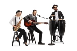 Man playing an acoustic guitar, female sax player and a man conga drummer performing in a band isolated on white background
