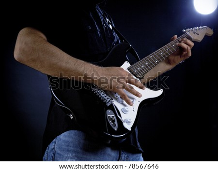 Man playing electrical guitar