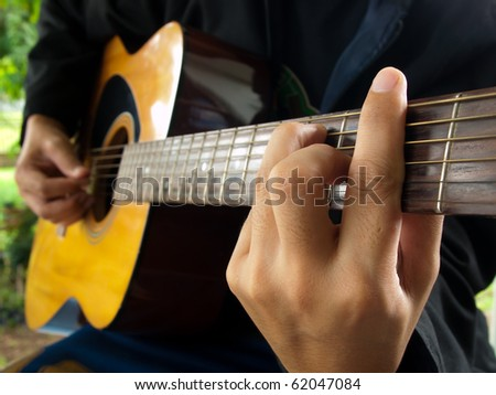 man playing folk guitar ,in the mood