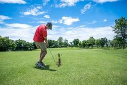 man playing golf with golf club on fairway