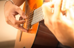 Man playing guitar , close up