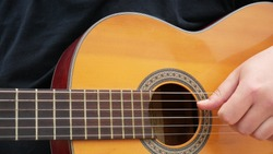 Man Playing Guitar Outdoors On The Acoustic Western Guitar With Steel. Romantic Mood, Musical Instrument, Close-Up. Acoustic Guitar Arpeggios