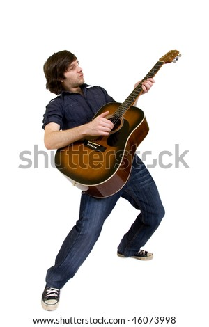 man playing his acoustic guitar with passion over white