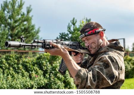 Man playing in lasertag shooting game, man with a gun, war simulation.