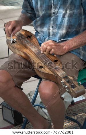 man playing string mountain...