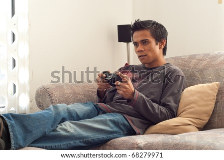 Man Playing Video Games on Couch