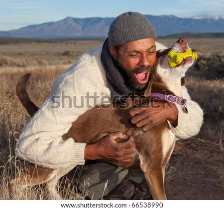 Man playing with his dog. Goofing, petting and howling.