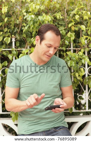 Man playing with his smartphone