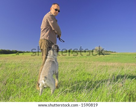 Man playing with the dog