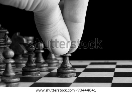 man plays chess and makes the first move a pawn