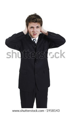 man plugging his ears over white background