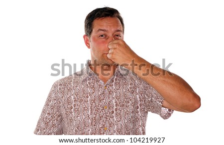 Man plugging nose after smelling something with a foul odor - stock photo