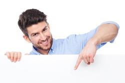 Man pointing at blank poster