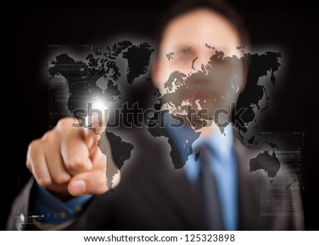 Man pointing his finger on a digital world map