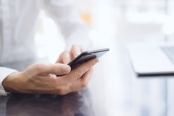 Man pointing on smartphone screen, chatting in social networks, meeting website, searching internet, sending sms, using text messenger or online banking. Close up of male hands