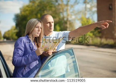 man points the direction at the road
