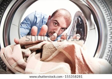 man portrait from inside of washing machine