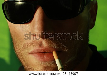 Man portrait with eyeglasses smoking
