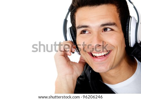 Man portrait with headphones listening to music - isolated over white