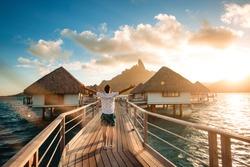 man posing on dock on sunset. tropical resort
