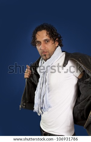 man posing removing jacket in studio