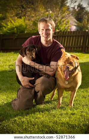 Man posing with his dogs