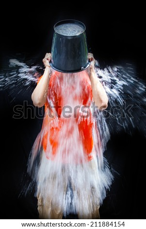 man poured a bucket of ice pour yourself on a black background