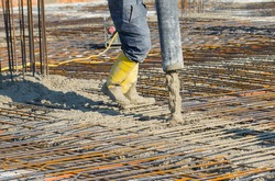 Man pouring concrete directing the pump