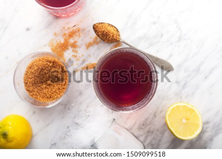 Man Pouring Homemade Isotonic Energy Drink. Glass With Red Liquid, Natural Sport Beverage. It Usually Contains Salt and Sugar and Maintains Optimal Hydration by Replacing Vital Minerals
