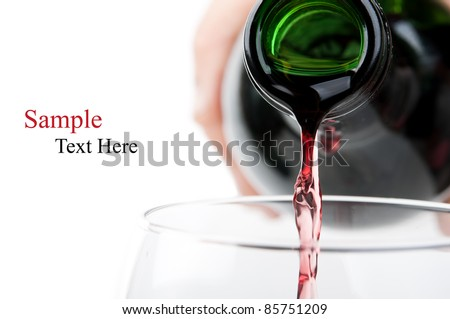 Man pouring red wine into a glass isolated on a white background