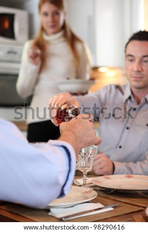 Man pouring wine