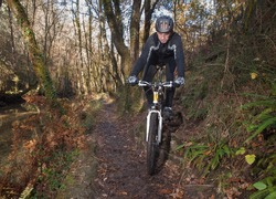Man practicing mountain bike in the forest in Galicia, Spain.