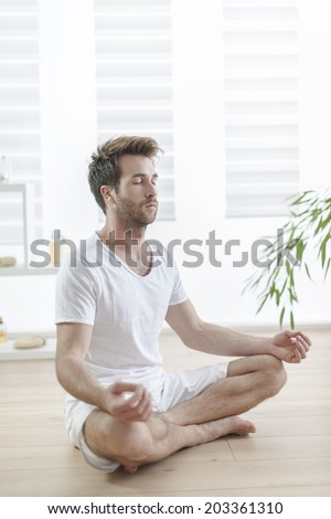 man practicing yoga in the lotus position
