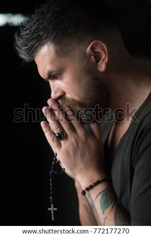 Man praying hands with rosary beads hoping for best. Human emotion facial expression feeling. Prayer, people, church. #772177270