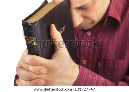 Man Praying Holding the Bible isolated on white - stock photo
