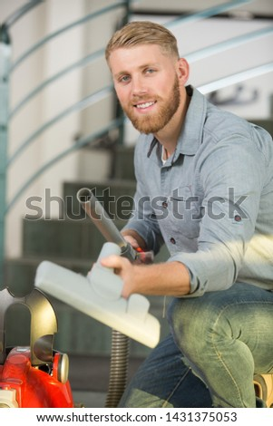 man preparing a vacuum cleaner #1431375053
