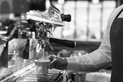 Man Preparing Coffee at Coffee Machine