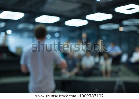 Man Presenting to Audience. Presentation. Blurred De-focused #1009787107