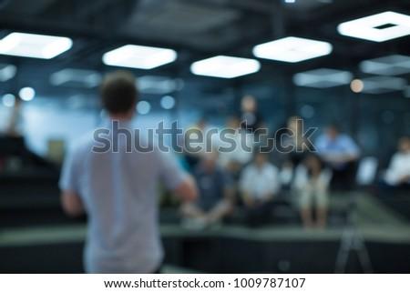Man Presenting to Audience. Presentation. Blurred De-focused #1009787107