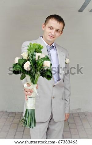 man presents flowers